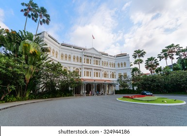 SINGAPORE - 07 AUG 2015: Grand facade of the luxurious Raffles Hotel in downtown Singapore, with its beautiful gardens.