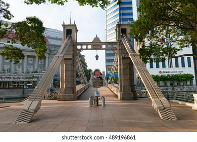 SINGAPORE - 07 AUG 2015: Historic Cavenagh Bridge, spanning the Singapore River near Raffles Place.
