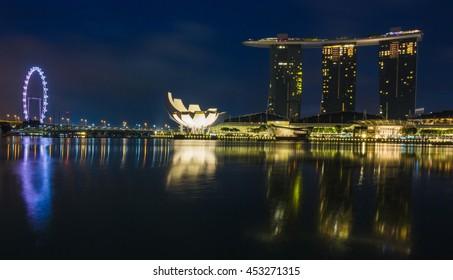 SINGAPORE, SINGAPORE - 08 AUG 2015 : Singapore city lights, ArtScience Museum, Marina Bay Sands and Helix Bridge at night, Singapore