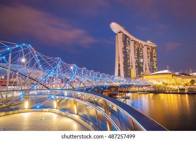 SINGAPORE - 10 APRIL 2016: Helix bridge and Marina Bay sands during twilight in Singapore on 10 April 2016