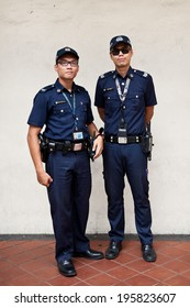 SINGAPORE - 10 FEBRUARY: Unidentified police on patrol in Little India on February 10, 2014 in Singapore. Singapore's crime rate hit a 30 year low in 2013 with total crime cases falling 4.3 per cent.