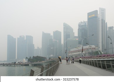 Singapore - 10th September, 2015: Haze fills the Marina Bay area. Haze is caused by the forest fire and burning of plantation in Indonesia. Also visible is the Merlion statue.