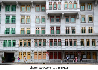 Singapore- 11 Aug, 2019: Colorful facade of the Old Hill Street Police Station in Singapore. For now the building is used by the Ministry of Communications and Information and the Ministry of Culture