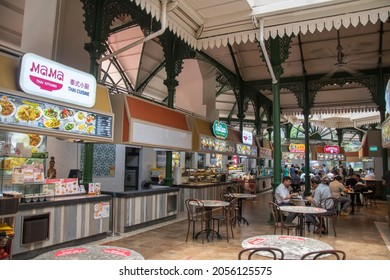 Singapore- 11 Oct, 2021: People enjoying food at the Lau Pa Sat foodcourt. Lau Pa Sat is a historic building located within the Downtown in Singapore.