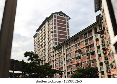 Singapore - 11/8/2019: Typical HDB blocks in Singapore. Clothes are mostly hanged outside.