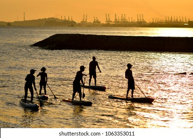 Singapore - 12 02 2017: Stand up paddle boarding at East coast park of Singapore