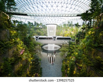 SINGAPORE, 12 May, 2019: The Rain Vortex, world's tallest (40m) indoor waterfall in Jewel Changi Airport in Singapore
