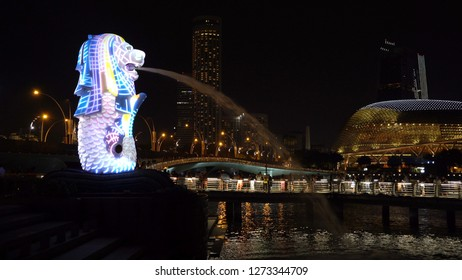 Singapore - 12/31/2018 : New Year Countdown 2019 at Merlion with colorful lights in Downtown Singapore City at night with skyscraper buildings background
