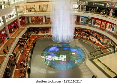 Singapore - 12th November 2018: Aerial view of interior of atrium of Marina Bay Sands shopping centre with futuristic colourful lighting and holographic floor show