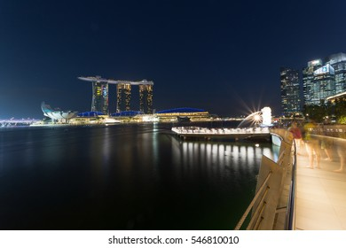 SINGAPORE - 13 DECEMBER: Merlion fountain and marina bay at night time at night on 13 December 2016 in Singapore