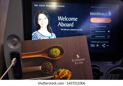 Singapore - 13 June 2018: entertainment media welcome screen with food menu inside Singapore airline flight economy class, Singapore