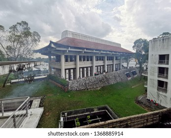 Singapore 14 April 2019: Family at Mandai Crematorium and Columbarium Complex burn offering to pray ancestors during Chinese Qing Ming Festival, also known as Tomb Sweeping Day.