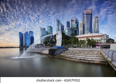 Singapore - 14 March 2015 - Morning Light shine on Merlion and Raffles Place, Raffles City, Central Business District in Singapore