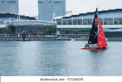 Singapore, 16 September 2017: Image of DBS bank boat on sea water near Marina Bay Sand and other buildings during F1 racing period.