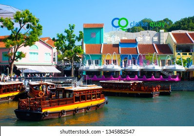 Singapore, Singapore 16-03-2019 A tourist woman is traveling at Clarke Quay in Singapore.