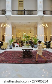 SINGAPORE -17 APRIL 2015- Opened in 1887 and located in the Civic District, the colonial style Raffles Hotel is the most famous luxury hotel in Singapore and a historic landmark.