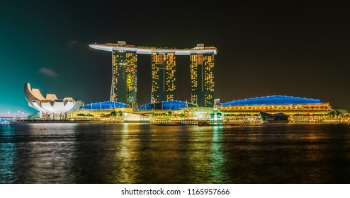 SINGAPORE - 17 Jul 2014: the ArtScience Museum and the Sands resort and casino reflect in the Marina Bay, in Singapore.