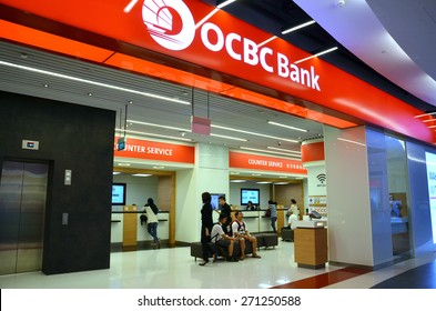 SINGAPORE - 18 APR: Customers waiting to be served in OCBC Bank in Singapore on 18 April, 2015. OCBC oversea Chinese Banking Corporation is a financial services organisation based in Singapore.