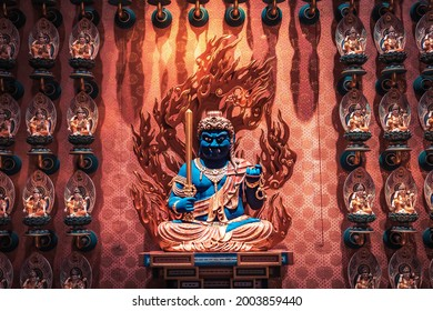 Singapore, Singapore – 18 December 2019: Acala deity in Buddha Tooth Relic Temple in Singapore in Chinatown
