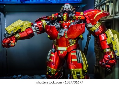 Singapore - 2 Dec, 2019: Iron man in Hulk Buster suit at the battle field setting on display in store. Action figures display from famous Marvel comic.