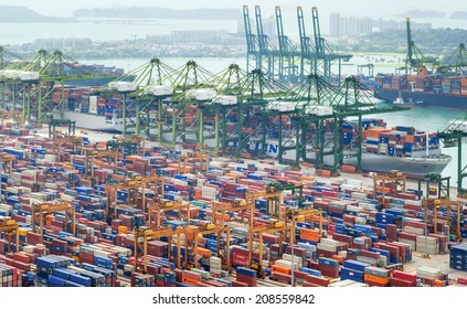 SINGAPORE - 2 JAN, 2014: Commercial port of Singapore. Bird eye panoramic view of busiest Asian cargo port with hundreds of ships loading export and import goods and thousands of containers in harbor