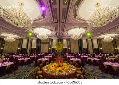 Singapore, 20 Jan 2013: Grand ballroom interior at Shangri-la Hotel with chandeliers and table setups.