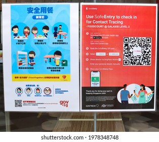 SINGAPORE - 20 MAY 2021. An eatery in Fusionopolis advises patrons on the Covid-19 safety measures by displaying on the door, information in English and Chinese languages.