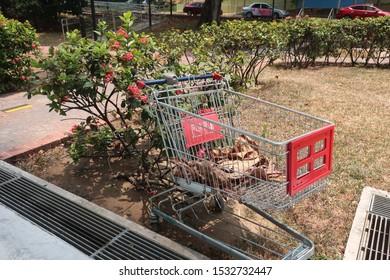 Singapore - 20 September 2019: Supermarket trolley abandoned at HDB housing estate