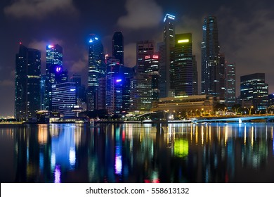 Singapore, 2017 January 10 - Landscape of the Marina Bay financial buildings skyscrapers at night
