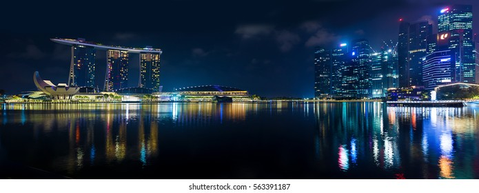 Singapore, 2017 January 10 - Landscape of the Marina Bay Sands hotel and art and science museum financial buildings skyscrapers at night
