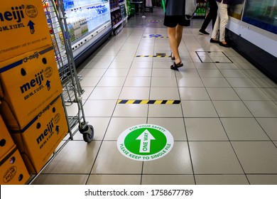 Singapore 2020Jun18 Directional floor stickers one-way only, installed at NTUC Fairprice supermarket (improve social distancing measures) for Phase 2 re-opening on Jun19; Covid-19 coronavirus outbreak