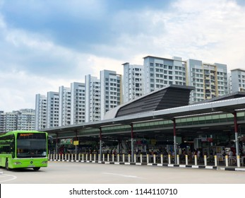 Singapore, 21 July 2018 - Bus maneuvering into Punggol temporary bus interchange near residential apartments at Punggol Central, located adjacent to the Punggol MRT/LRT Station.