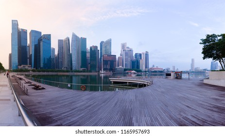 SINGAPORE - 22 Oct 2017: Singapore's Central Business District skyline at sunrise, with high rise buildings and waterfront, from Marina Bay terrace deck.
