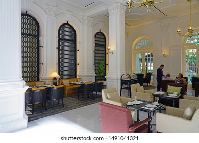 SINGAPORE -23 AUG 2019- View of landmark colonial style Raffles Hotel, a famous luxury hotel in the Civic District in Singapore opened in 1887 and reopened after renovation in August 2019.