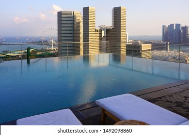 SINGAPORE -24 AUG 2019- Aerial cityscape view of downtown Singapore seen from the top of the Andaz Singapore hotel swimming pool in the DUO galleria, a building complex in the Bras Basah Bugis area.