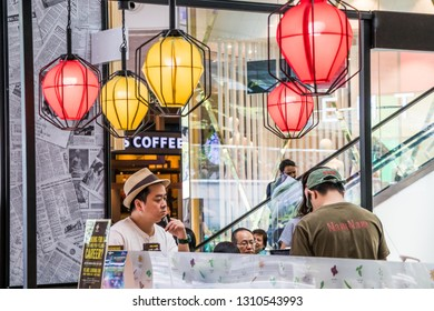 Singapore - 24th December 2018: Man waiting for coffee in Singapura shopping mall. There are many coffee shops in the city.