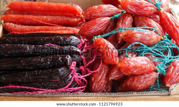 Singapore. 26 June 2018. Close-up of bundles of dried Chinese pork sausages sold commonly in Chinatown, used to flavor Asian dishes and noodles.