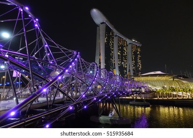 SINGAPORE - 27 AUG: Helix Bridge and Marina Bay Sands in Singapore on 27 August 2016