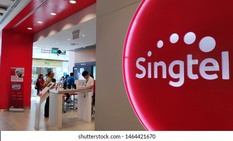 Singapore, 27 Jul, 2019: Customers visit Singtel retail shop in Singapore. Singtel Ltd is one of the three major telcos in Singapore.