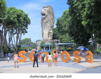 SINGAPORE - 28 May, 2014: Unidentified people take photos of Merlion in Sentosa Island. Sentosa island is a popular island resort featuring Universal studio visited by 5 million people a year.
