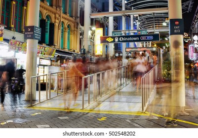 Singapore - 29 Aug 2015 : Motion blur of crowded people walk in and out from Chinatown MRT station. Intentionally blur the people.
