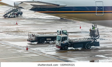 Singapore - 29 June 2019: Lavatory service vehicles for emptying and refilling lavatories onboard aircraft of a Singapore Airlines machine at apron of the Singapore International Airport