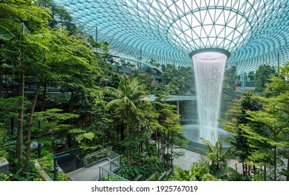 Singapore - 30 Aug 2019: Jewel Changi Airport is a new terminal building under a glass dome, with indoor waterfall and tropical forest, shopping malls and dining, in Singapore