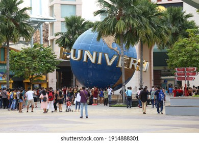 Singapore - 30 March, 2017:  Tourists and people visiting around Universal Studios world globe Universal Studios Singapore is a theme park with a collection of world-class entertainment for all age