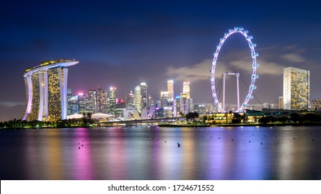 Singapore 31. December 2019 :  View of the downtown skyline, with the Gardens by the Bay, the Marina Bay Sands Hotel and the Singapore Flyer