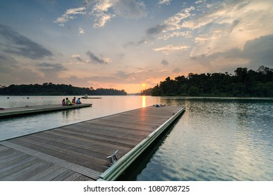 Singapore, 31 Mar 2018: Beautiful sunset at MacRitchie Reservoir which is Singapore's oldest reservoir completed in 1868. The Reservoir caters to fitness fanatics and water sports enthusiasts.
