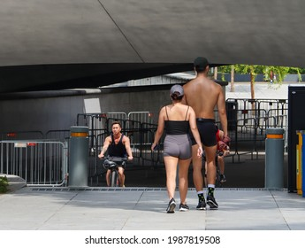 SINGAPORE - 5 JUN 2021: Two adults walk briskly at The Esplanade. Regular brisk walking can promote one's physical and mental health if one has lots of work to do and feel depressed or burnt out.