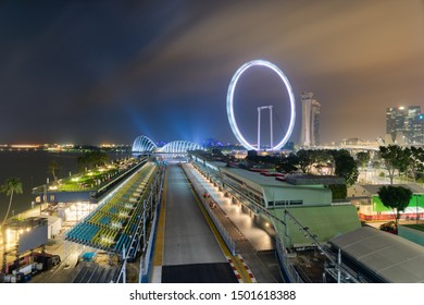 Singapore - 9 Sep 2019: the Marina Bay Street circuit welcomes the Singapore night race Formula One Grand Prix,  passing near the Flyer Ferris wheel, the Gardens by the bay and the Sands resorts.