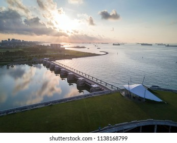 Singapore - Apr 05 2018: Beautiful sunrise scene at Marina Barrage. It is Singapore's 15th reservoir and the first in the heart of the city.