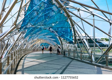 SINGAPORE, SINGAPORE - APR 07, 2018: Helix Bridge or DNA bridge - tourist attraction place in Marina bay, Singapore